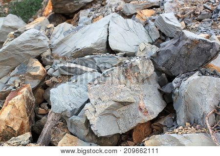 Cracks and colorful layers of sandstone background. A big heap of sandstones storage space of various natural sandstone. The pattern of the variegated sandstones. Layers of toning colored large stones