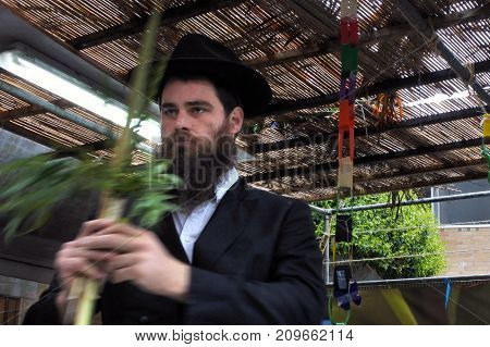 Jewish Orthodox Rabbi Blessing On The Four Species In A Sukkah