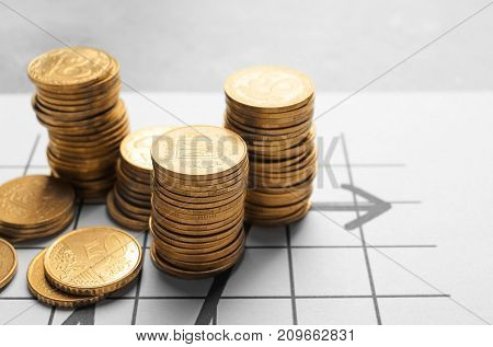Stacks of coins on business document, closeup
