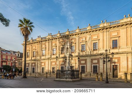 SEVILLA,SPAIN - OCTOBER 1,2017 - View at the building General Archive of the Indies in Sevilla. Sevilla is situated on the plain of the river Guadalquivir.