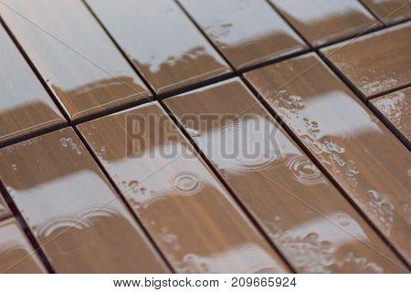 Wet wooden floor boards with water drops