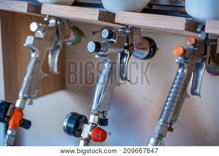 Various pneumatic spray guns or pistols for airbrushing