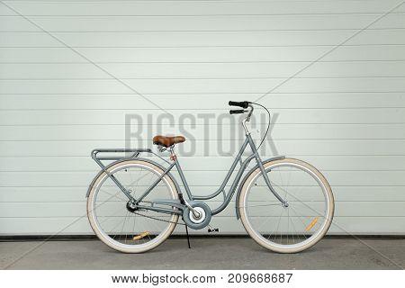 Retro bicycle near white wall