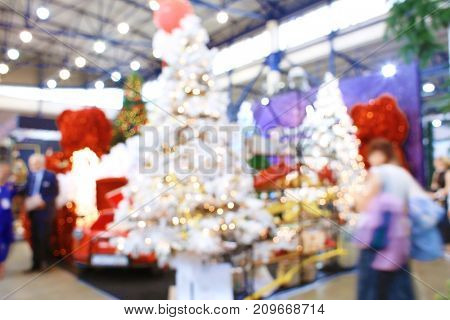 Blurred view of decorated Christmas tree in shopping center