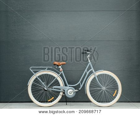 Retro bicycle near color wall