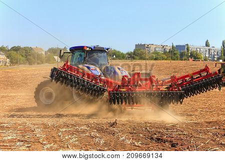Agriculture. The Tractor Prepares The Ground For Sowing And Cultivation. Agronomy, The Concept Of Fa