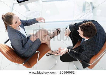 business partners talking at Desk.the view from the top