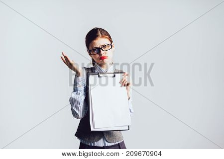 girl secretary in glasses grieves showing file