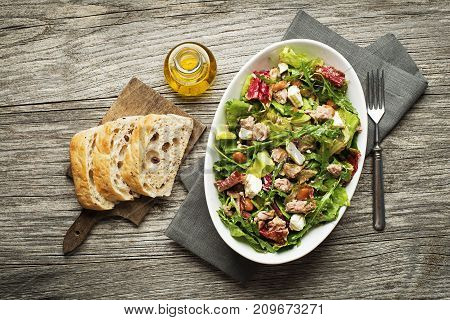 Tuna salad with lettuce beans and cheese on wooden table