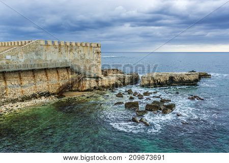 Walls of Ortygia isle on Ionian Sea Syracuse city Sicily Island in Italy