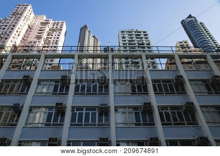 Low angle view on apartement buildings in different colors in Hong Kong, Asia