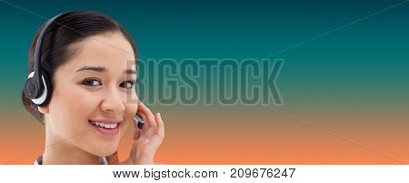 Close up of a smiling operator posing with a headset against orange and turquoise background