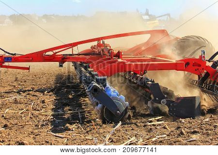 Agricultural Machinery For The Fields. Rattot Plow Field. The Farmer In The Tractors Is Preparing Th