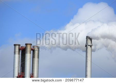 Chimneys and smokestacks of an industrial plant Chemical industrial industry