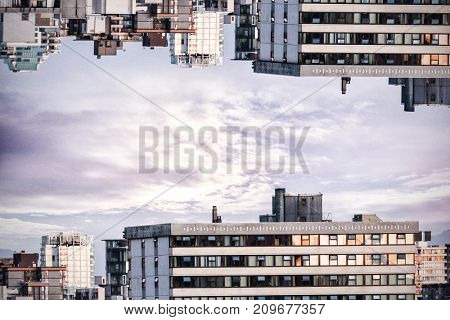 Towers in city against sky during sunset