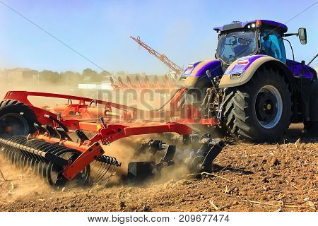 Agriculture. The Tractor Prepares The Ground For Sowing And Cultivation.    Work Of A Plow On The Fi