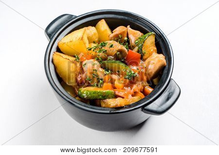 potato with meat and vegetables in the pot