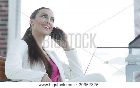 female employee talking on the smartphone
