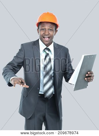 Portrait of happy smiling business man in helmet