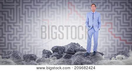 Standing businessman  against grey maze Standing businessman on white background