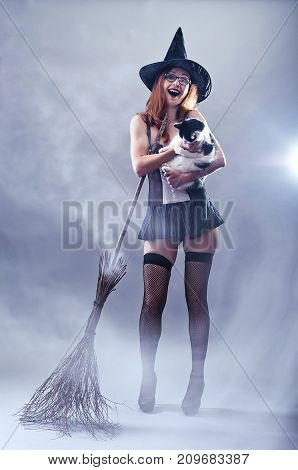 Woman In Witch Costume Holding A Cat, Photos In The Smoke.