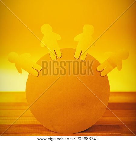 Conceptual image of blue paper cut out figures on circle