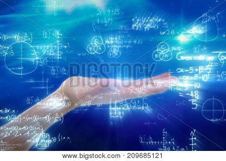 Hand of man pretending to hold an invisible object against digitally composite image of mathematical equations with diagram