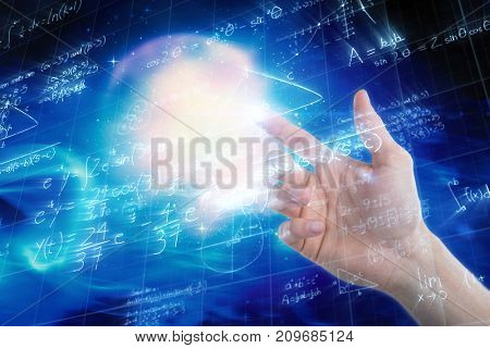 Hand of man pretending to touch an invisible screen against low angle view of digitally generated image of mathematical problems