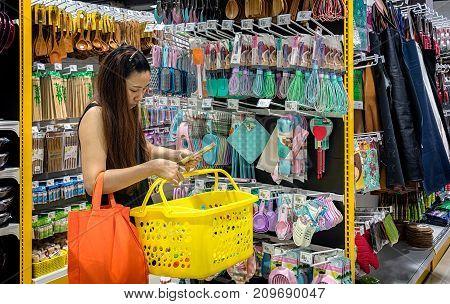 BANGKOK THAILAND - OCTOBER 15: Customer shops for kitchen supplies at Mr. DIY in Victoria Garden in Bangkok on October 15 2015.