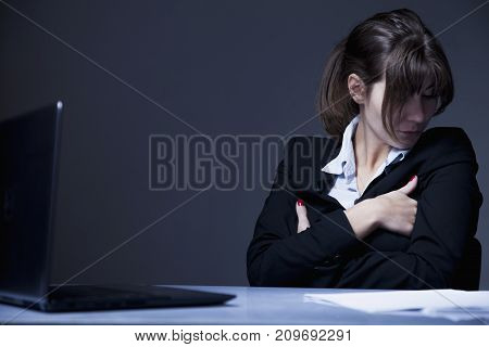 I hate my office work. Portrait of young business woman working overtime with low wages without career perspective. (Body language gestures psychology concept)