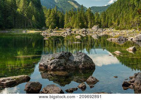 Mittlerer Gosausee In Austria In Summer, Rocks In Water