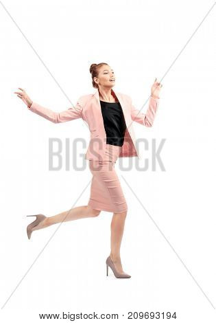 Young businesswoman running on white background