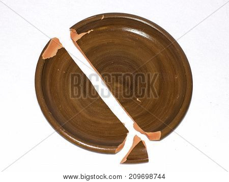 Broken Clay Dish. Isolated On White Background
