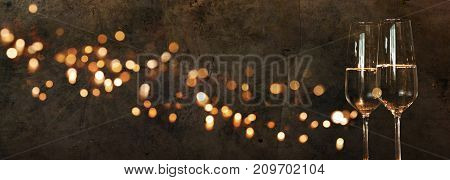 Solemn background with golden lights and champagne for new year congratulations