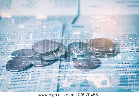 double exposure of money coin with book bank or saving account passbook and city background business savings investment finance and banking concept blue color tone effect