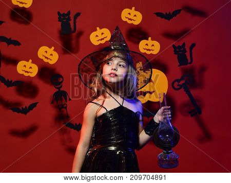 Halloween Party And Decorations Concept. Girl With Interested Face