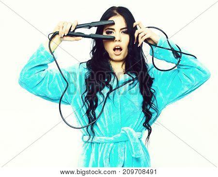 Sexy Girl Posing In Turquoise Velour Bathrobe With Straightener