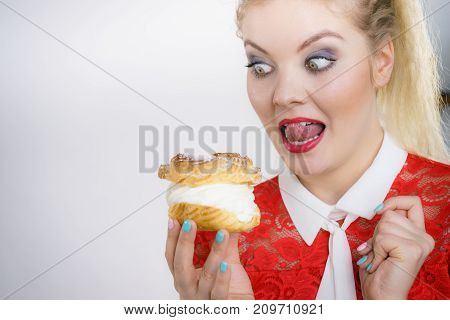 Woman Holding Cupcake Dessert With Cream