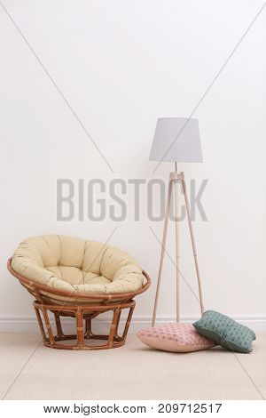 Interior of beautiful room with armchair and light carpet
