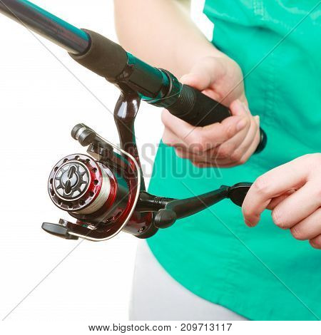 Person Holding Fishing Rod, Spinning Equipment.