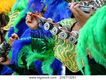 percussion instruments feathers and blue and yellow carnival embroidery