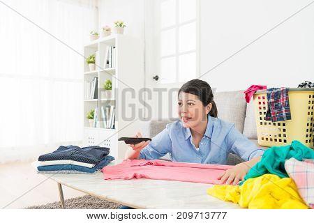 Happy Pretty Woman Holding Tv Remote Control