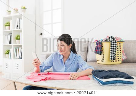 Beauty Housewife Folding Clothing In Living Room