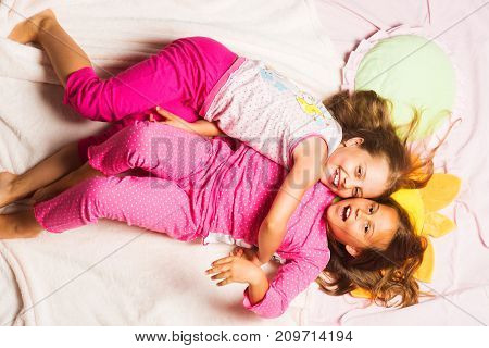 Kids In Pink Pajamas Having Fun. Children With Smiling Faces
