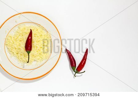Grated Cheese With Spices And Hot Chilli On White Background .