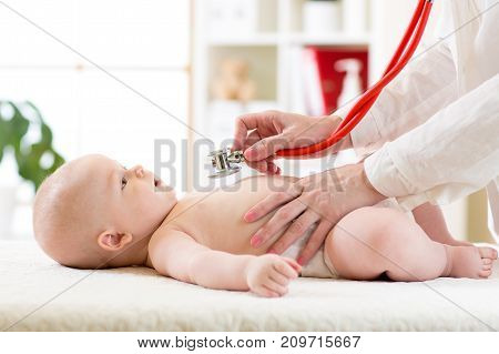 Stethoscope listening to baby's heart beat or lungs