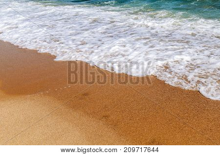 Foam wave on sea close with beach