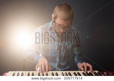 Man Playing On A Synthesizer