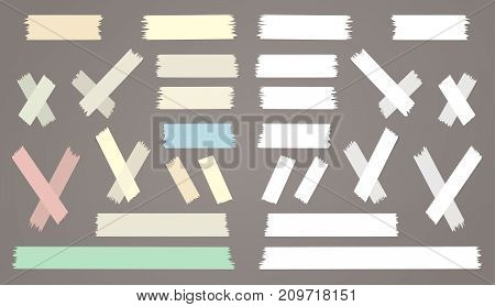 Colorful and white different size adhesive, sticky, paper pieces on brown background for text