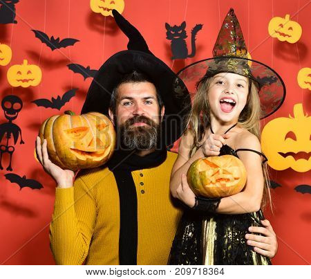 Girl And Bearded Man With Happy Faces On Red Background